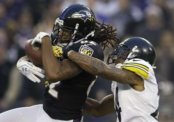 Pittsburgh Steelers cornerback Ike Taylor, right, breaks up
