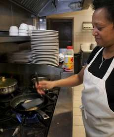 Co-owner and chef Toni Clifton cooks Cajun salmon