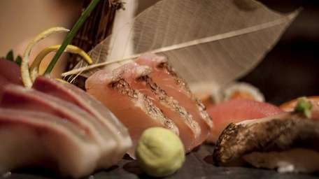 An artful platter of sushi and sashimi served