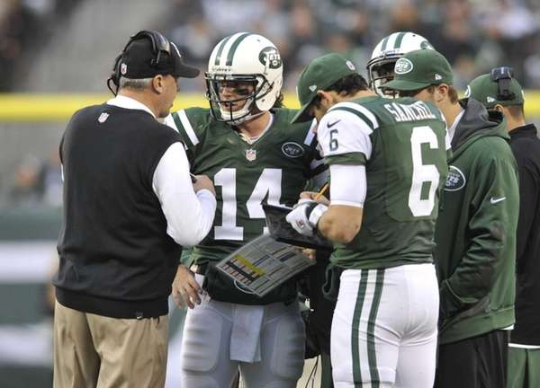 Rex Ryan talks to Greg McElroy in the