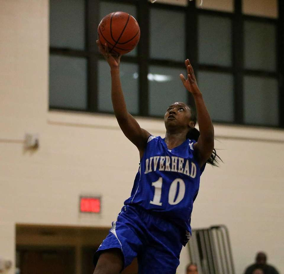 Riverhead's Naysha Trent takes a steal in for