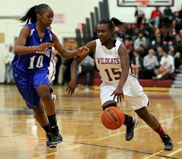 Whitman G Katira Jemmott moves the ball past