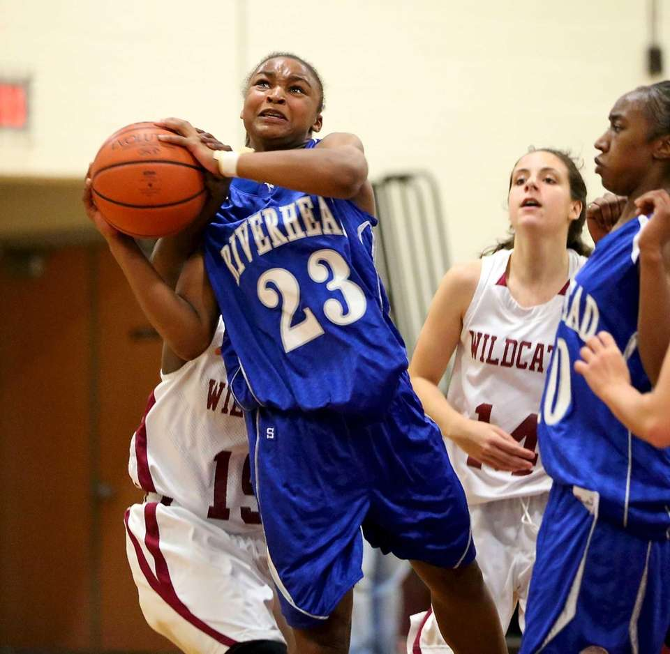 Riverhead G Shanice Allen is fouled while putting