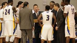 Hofstra head coach Mo Cassara, center, directs his
