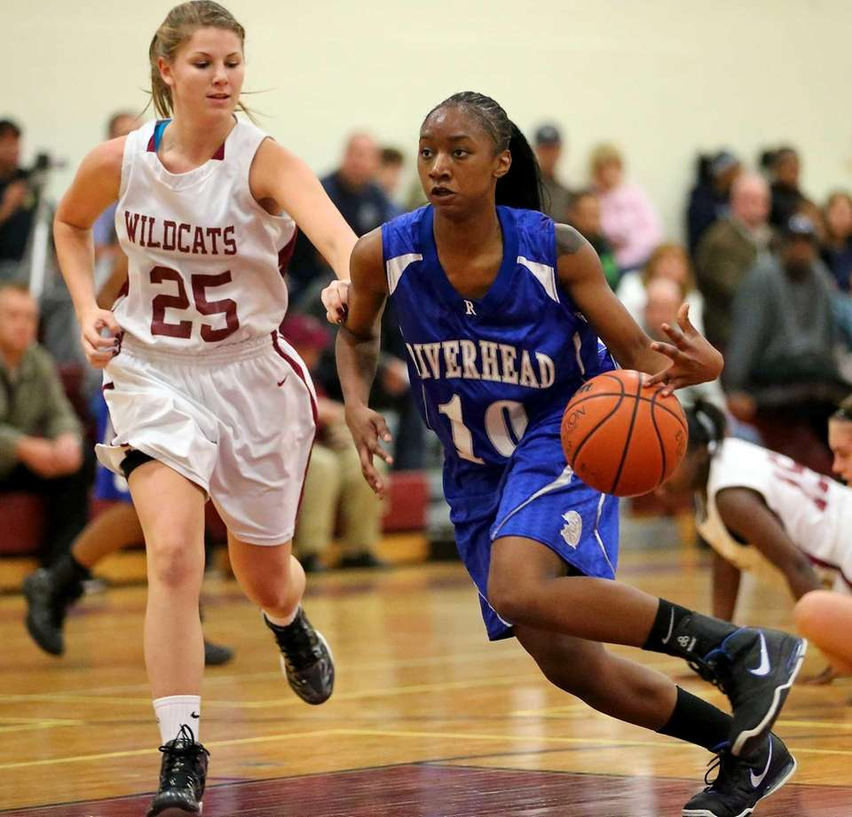 Riverhead G Naysha Trent drives the paint against