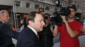 NHL commissioner Gary Bettman arrives for a negotiation