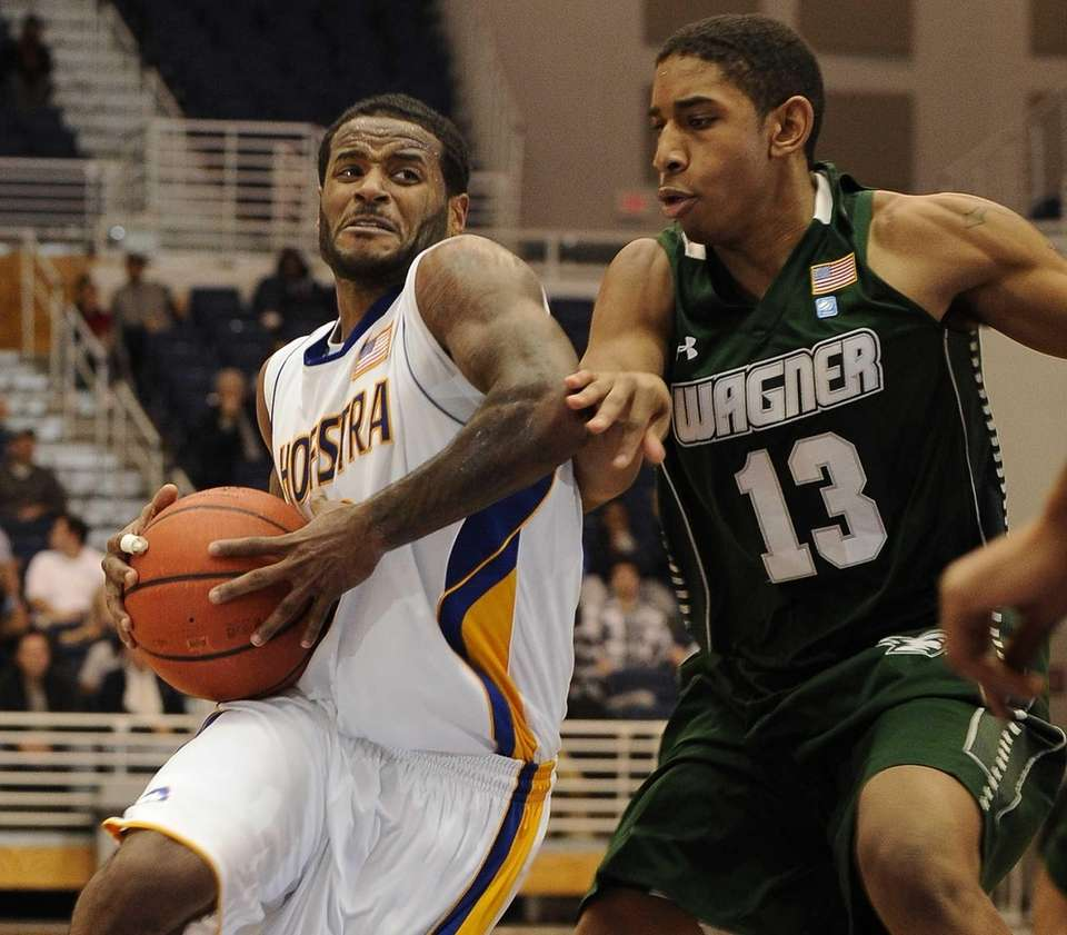 Hofstra guard Stevie Mejia drives past Wagner guard