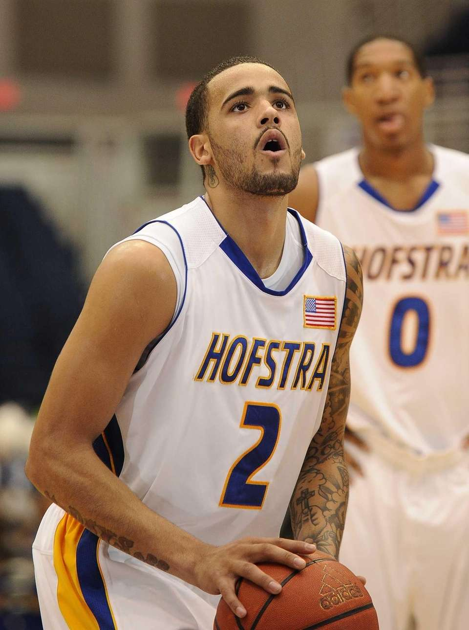Hofstra guard Taran Buie sets up his foul