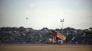 Debris from superstorm Sandy is dumped at a