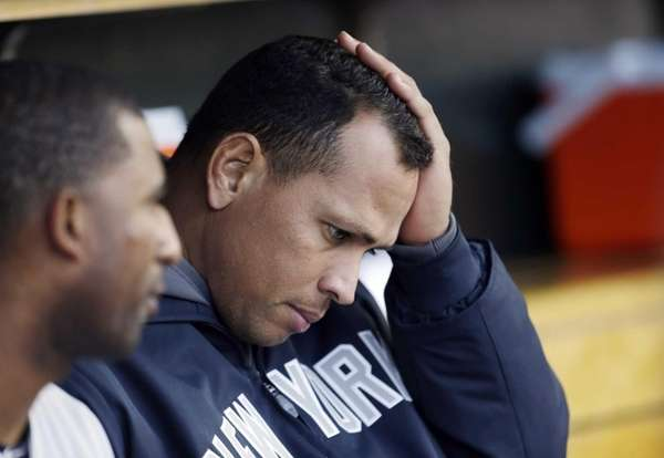 Alex Rodriguez watches from the bench during Game