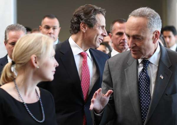 New York Gov. Andrew Cuomo, flanked by U.S.