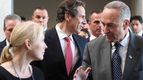 New York Gov. Andrew Cuomo, flanked by U.S.
