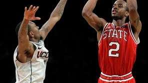 North Carolina State's Lorenzo Brown (2) shoots over