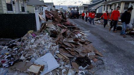 Debris covers Wisconsin Street in Long Beach as