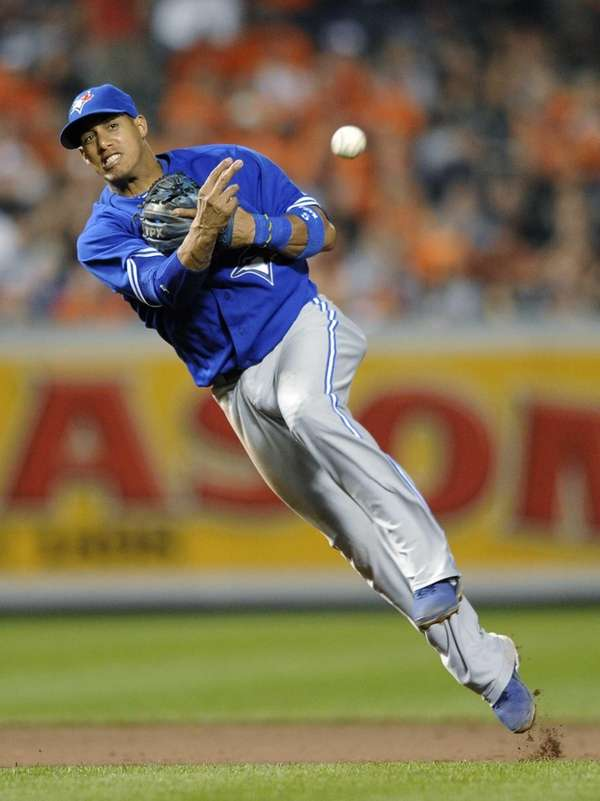 Then-Toronto Blue Jays shortstop Yunel Escobar throws to