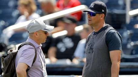 Yankees GM Brian Cashman, left, and manager Aaron