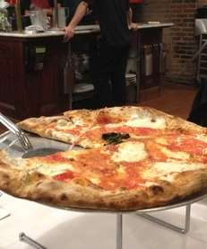 At Grimaldi's in Garden City, pizza is made