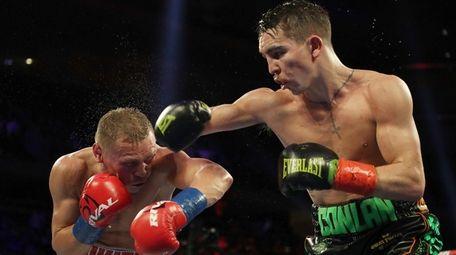 Michael Conlan punches Vladimir Nikitin during their featherweight