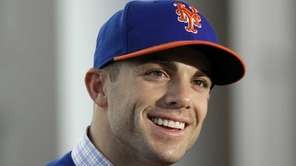 David Wright answers questions during an interview at