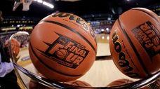 Basketballs sit in a rack during Michigan State