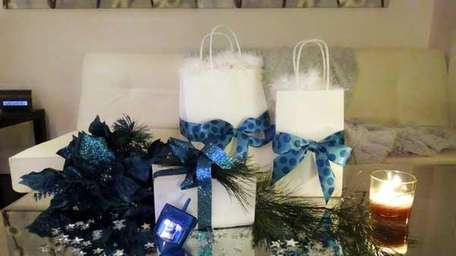 Tie ribbons around small shopping bags, group with