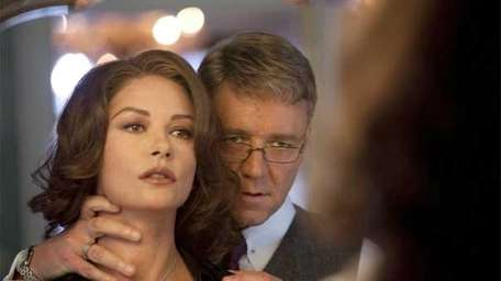 Mayor (Russell Crowe) subtly threatens his wife (Catherine