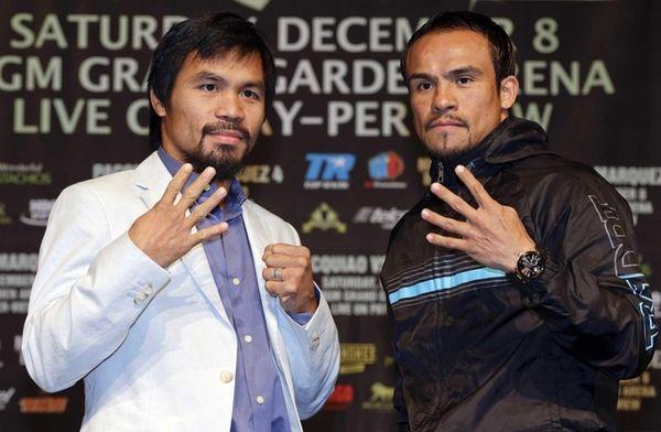 Manny Pacquiao, left, and Juan Manuel Marquez, right,