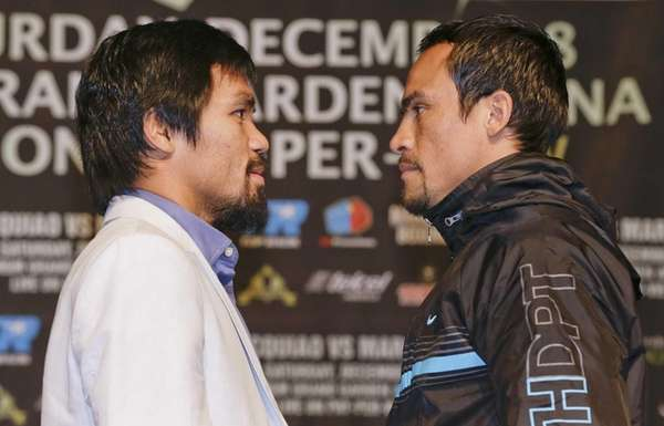 Manny Pacquiao, left, and Juan Manuel Marquez pose