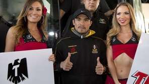 Juan Manuel Marquez, center, poses for photos upon