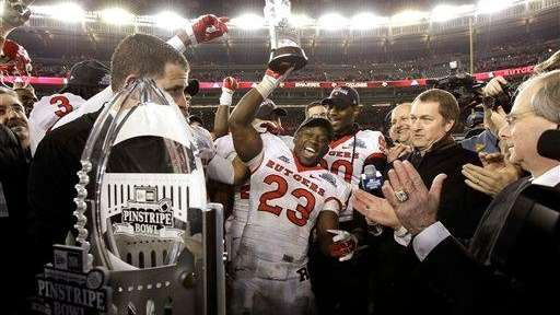 Rutgers running back Jawan Jamison holds up the