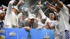 Hofstra coach Joe Mihalich is showered with water