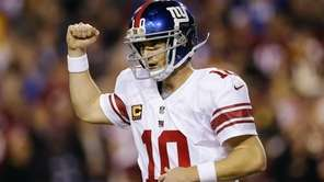 Eli Manning celebrates a touchdown pass to tight