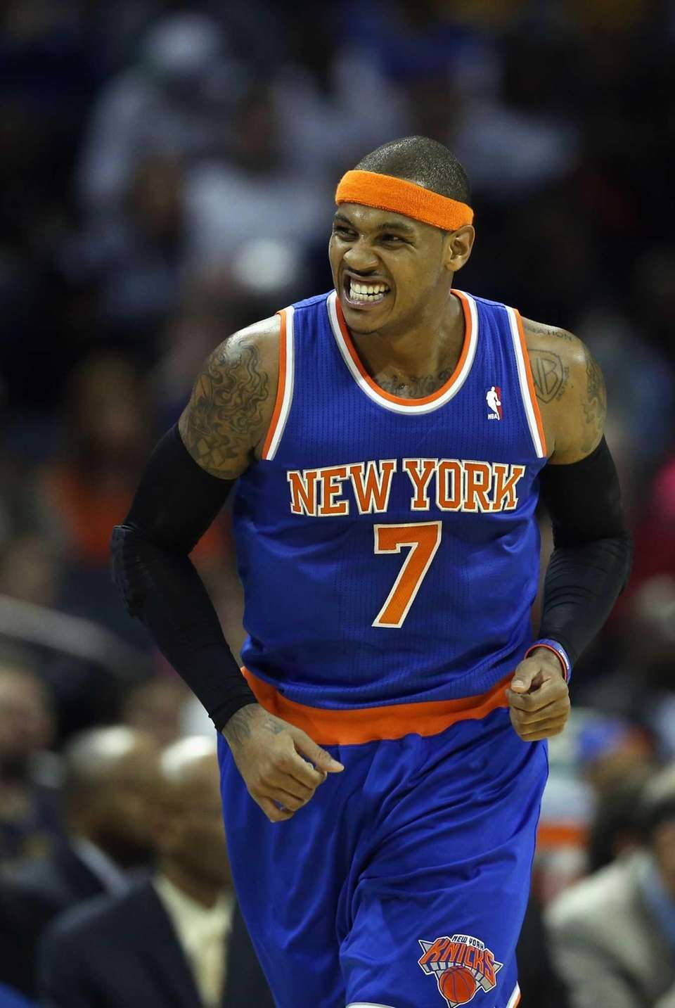 Carmelo Anthony reacts after making a basket during