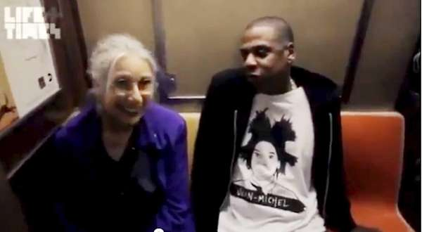 Passenger Ellen Grossman and Jay Z talking to
