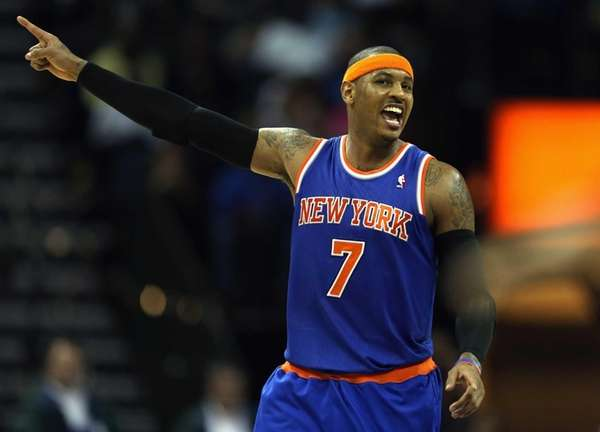 Carmelo Anthony reacts after a shot during a