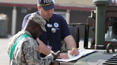 TSA employee Chris Kotula, left, on loan to