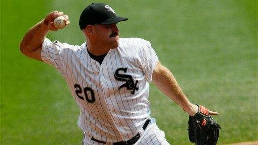 Chicago White Sox third baseman Kevin Youkilis fields
