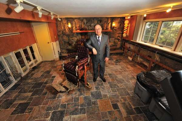 Homeowner Anthony Ballato stands in his den next