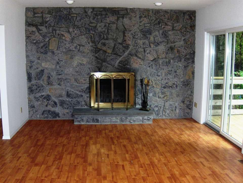 There are two stone fireplaces in the Miller