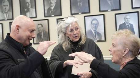 Longtime Lindenhurst resident Maureen Stoll, center, discusses her