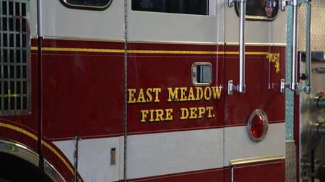 An engine loaned by East Meadow sits in