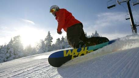 A snowboarder on the slopes during opening day