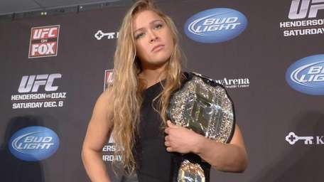 Ronda Rousey shows off her UFC bantamweight championship