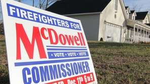 A sign for McDowell for Commissioner sits on