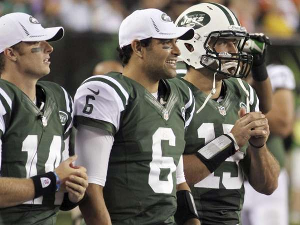 Greg McElroy, Mark Sanchez and Tim Tebow watch