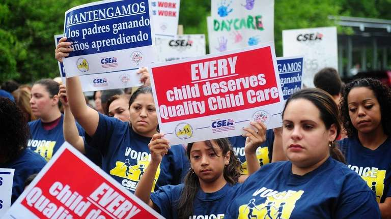 Child care providers, parents, children and others gather