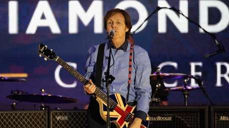 Sir Paul McCartney performs on stage during the