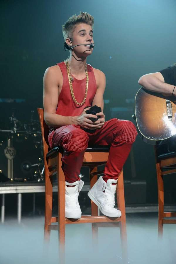 Justin Bieber performs onstage during Q102's Jingle Ball