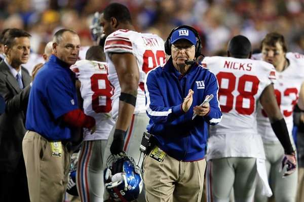 Tom Coughlin reacts after the Giants score in