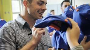 David Wright distributes caps and signs autographs for